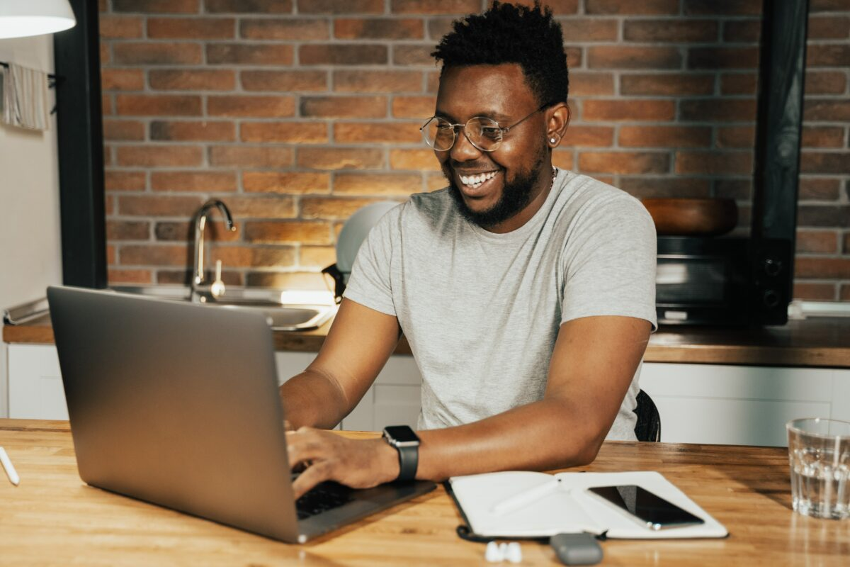 A happy man while working on a laptop