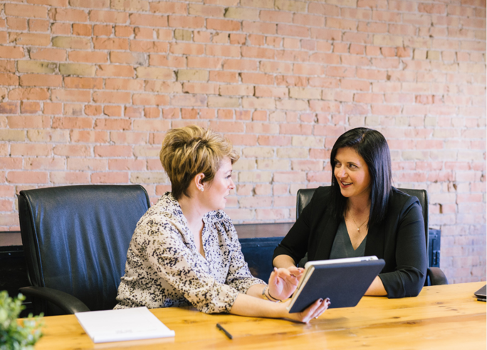 Picture of two businesswomen in a meeting in an office