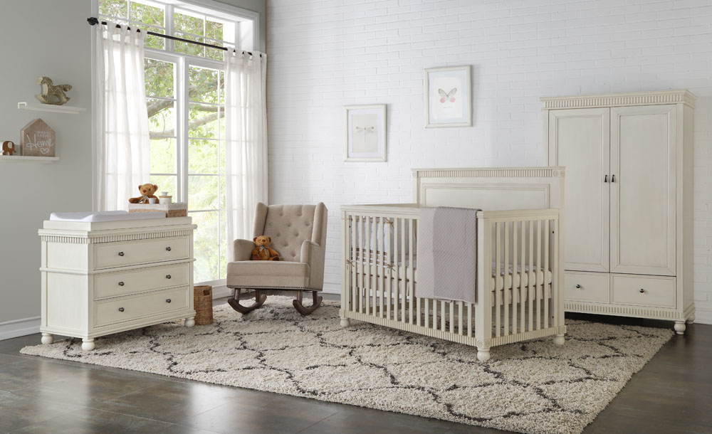 A baby room with crib, cabinets and rocking chair